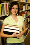 Image of a girl student holding books