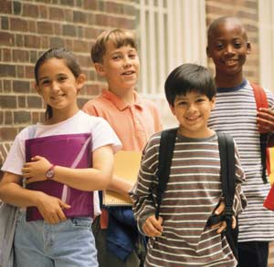 A photograph of school-age children from the cover of the report.